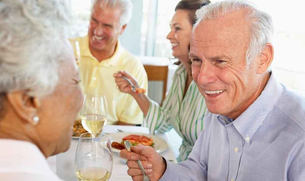 enjoying-a-meal-at-our-senior-apartments-in-rochester_ruftwz